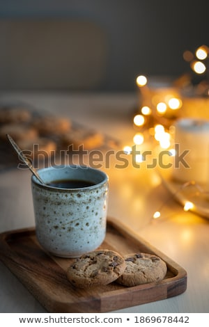 Chocolate aromatic candle on Christmas and New Years glitter bac Stock photo © Anneleven
