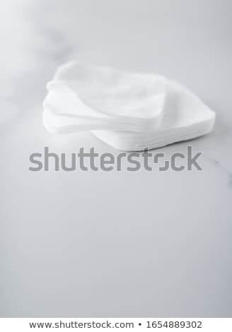Organic cotton pads on marble background, cosmetics and make-up  Stock photo © Anneleven