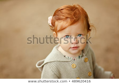 Stock photo: portrait of red haired girl in the autumn park
