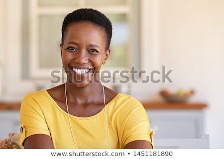 Mooie glimlachend zwarte vrouw portret lachend jonge Stockfoto © Edbockstock