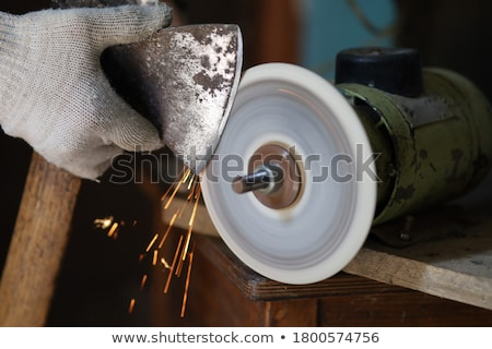 A manual worker using a hatchet. Stock photo © photography33