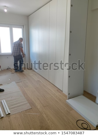 a carpenter fixing a closet door stock photo © photography33