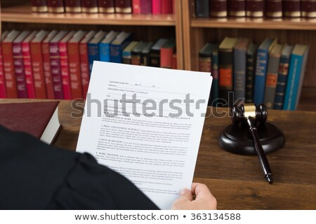 Judge reading the sentence Stock photo © broker