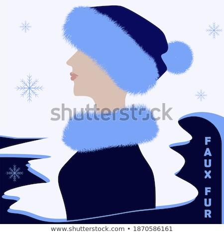 Pretty woman in fur trimmed winter hat Stock photo © stryjek