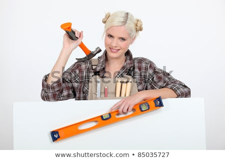 female carpenter with hammer and board left blank for your image stock photo © photography33