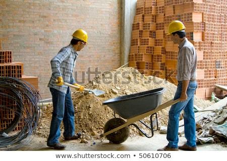 Boldog építőmunkás talicska mosoly ipar munkás Stock fotó © photography33