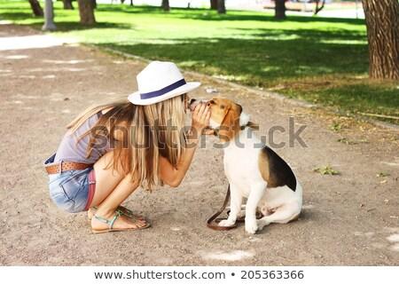 Nő csók kutyakölyök portré fiatal nő izolált Stock fotó © acidgrey