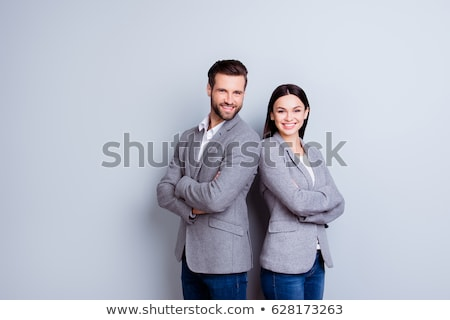 a business man and woman are standing with back to back stock photo © wavebreak_media