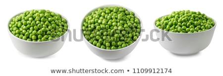 Pea Pod in bowl on a white background Stock photo © ozaiachin