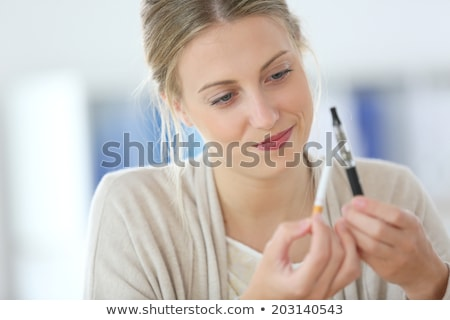 young woman opts for electronic cigarette stock photo © pasiphae
