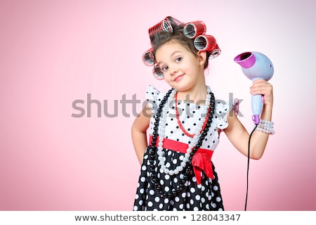 girl with hairdryer stock photo © kyolshin