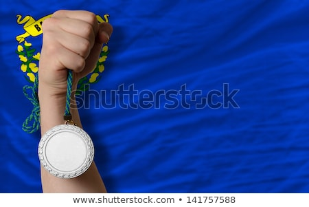 silver medal for sport and flag of american state of nevada stock photo © vepar5