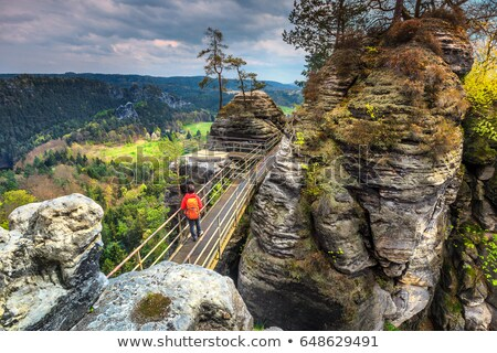 hiker in Natural Fort rock formation Stock photo © PixelsAway