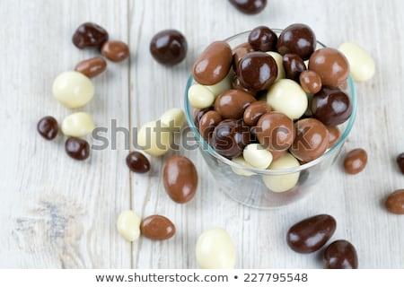 passas · de · uva · coberto · chocolate · tigela · pano - foto stock © raphotos