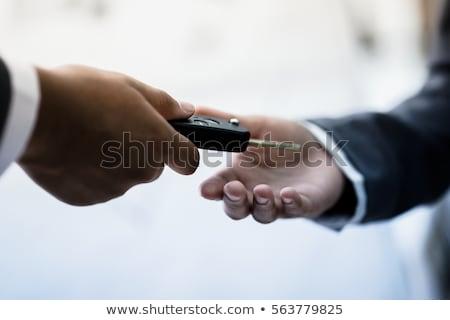 salesman handing over keys car businessman stock photo © hasloo