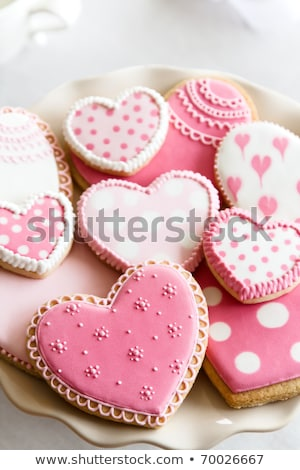 Array of heart-shaped cookies with pink frosting Stock photo © sarahdoow