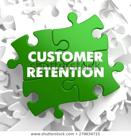Customer Retention on Green Puzzle. Stock photo © tashatuvango