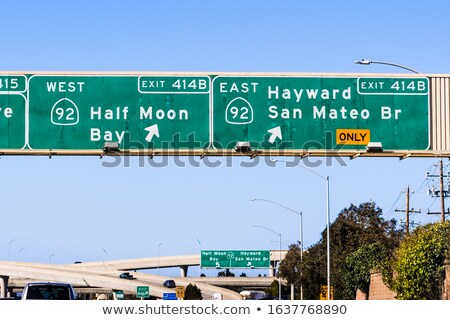 Green Freeway Road Sign Arrow Exit Ramp Route Direction Stock photo © iqoncept