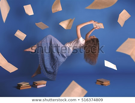 Portrait of a levitating woman with a book Stock photo © konradbak