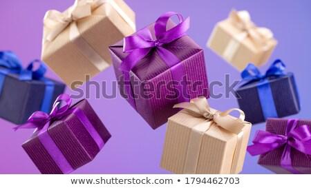 Lila caja de regalo violeta blanco cinta mesa Foto stock © milsiart