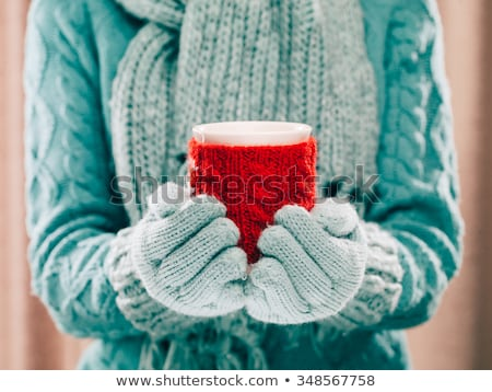 Woman holds a red coffee cup (vintage style color) Stock photo © nalinratphi