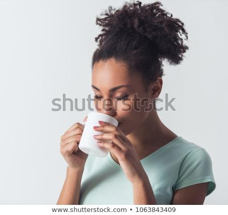 Vonzó boldog fürtös fiatal nő iszik kávé Stock fotó © deandrobot