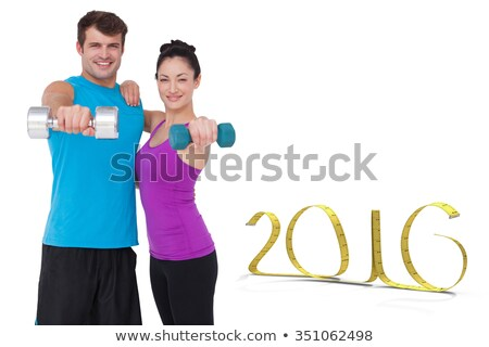 composite image of muscular woman exercising with dumbbells stock photo © wavebreak_media