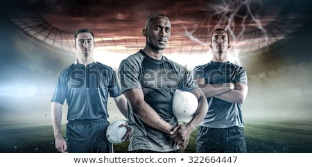 Frowning rugby player with arms crossed Stock photo © wavebreak_media