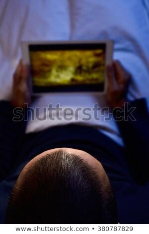 férfi · ágy · tv · nézés · fiatalember · nappali · zene - stock fotó © nito