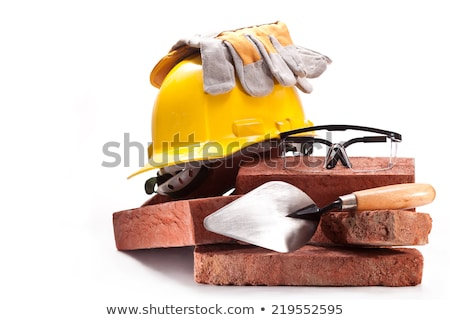 Construction worker with clay bricks on white Stock photo © Elnur