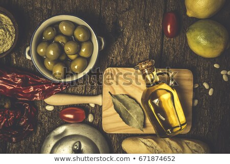 Extra virgin olive oil on old background Stock photo © marimorena