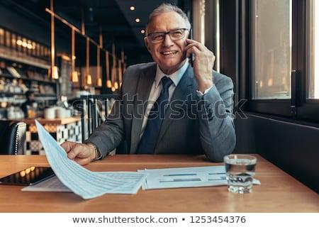 boldog · idős · üzletember · telefon · portré · beszél - stock fotó © nyul