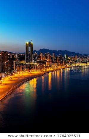nacht · panorama · stad · hemel · wolken · licht - stockfoto © sebikus
