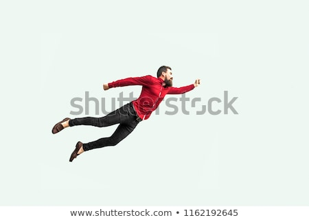 Flying · человека · молодые · счастливым · зонтик · изолированный - Сток-фото © Kurhan