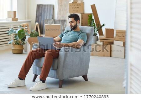 Ritratto sorridere giovani barbuto uomo seduta Foto d'archivio © deandrobot