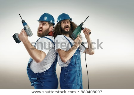 Funny repairman with drill isolated on white Stock photo © Elnur