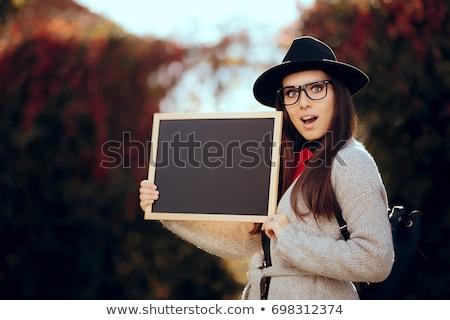 Feliz estudiante pizarra signo venta Foto stock © NicoletaIonescu