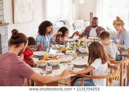 друзей молиться обеда мнение , держась за руки Сток-фото © LightFieldStudios