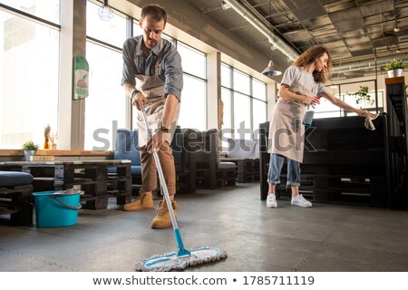 Woman sweeping in a cafe Stock photo © IS2