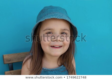 Close-up photo of smiling attractive woman in children clothes b Stock photo © deandrobot