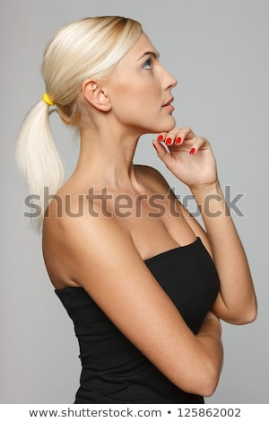 side view of a pensive woman standing with hands crossed stock photo © feedough