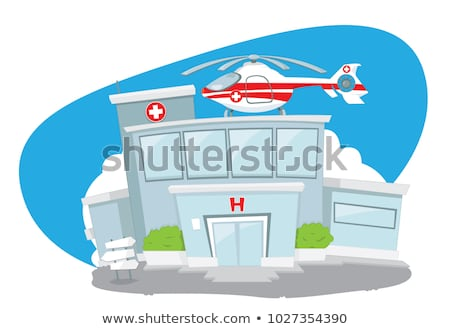 Foto d'archivio: Hospital Building With Helicopter On Its Roof And An Ambulance Hurrying While Its Driver Cheers