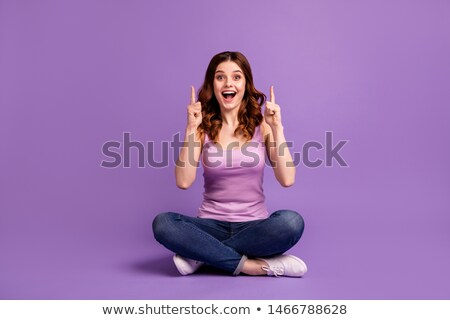 Portrait of an astonished girl dressed in tank-top Stock photo © deandrobot