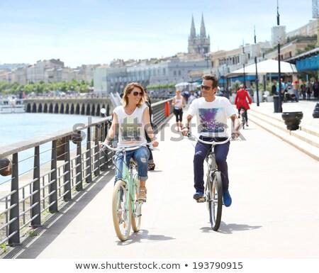 Nő befejezés dokk bicikli bicikli vakáció Stock fotó © IS2