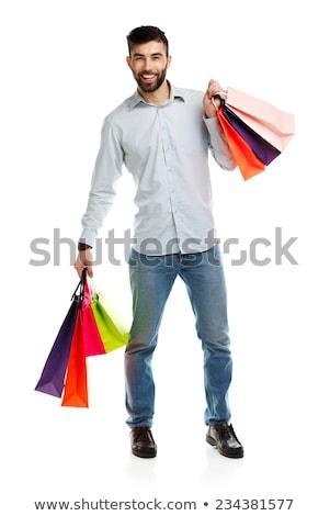 Boldog kaukázusi fiú tart bevásárlótáskák sok Stock fotó © RAStudio