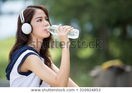 Stok fotoğraf: Güzel · genç · kadın · içme · suyu · egzersiz · park · yaz