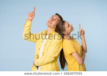 Młodych kochający para stałego odizolowany żółty Zdjęcia stock © deandrobot