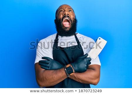 Wściekły młody człowiek kucharz gotować fartuch stałego Zdjęcia stock © deandrobot