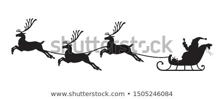 Сток-фото: Santa Claus In A Sleigh With Reindeer Silhouette