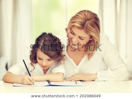cute · meisje · huiswerk · halfbloed · witte · boek - stockfoto © lopolo